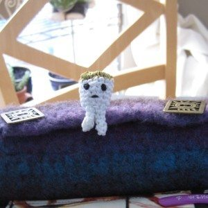 embroidery floss amigurumi tooth from front