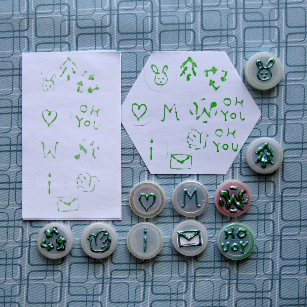 Stamps made from bottlecaps and three rounds of 3D paint; impressions after 2 and 3 rounds of paint shown.