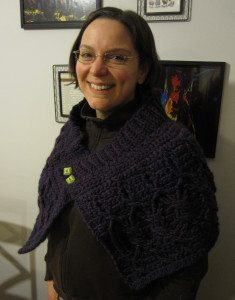 photo of me wearing the finished cabled wrap