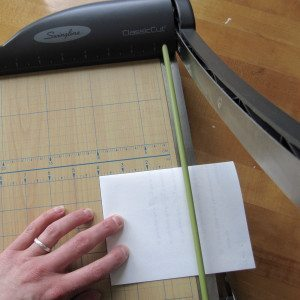 "photo of folded paper about to be trimmed to 4"" along edge"