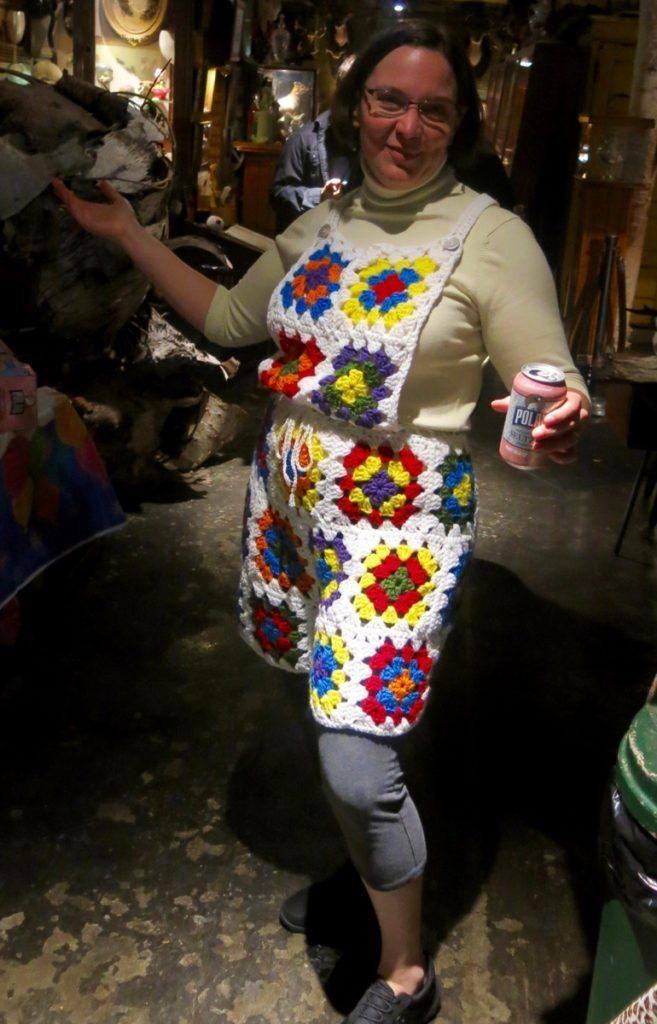 Me wearing granny square shortalls at the Main Street Museum