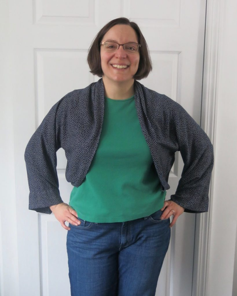 navy shrug-style jacket