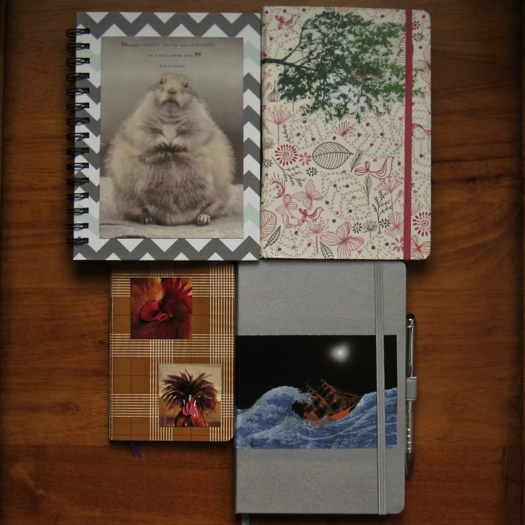 notebooks decorated with magazine cutouts and other paper, via mod podge