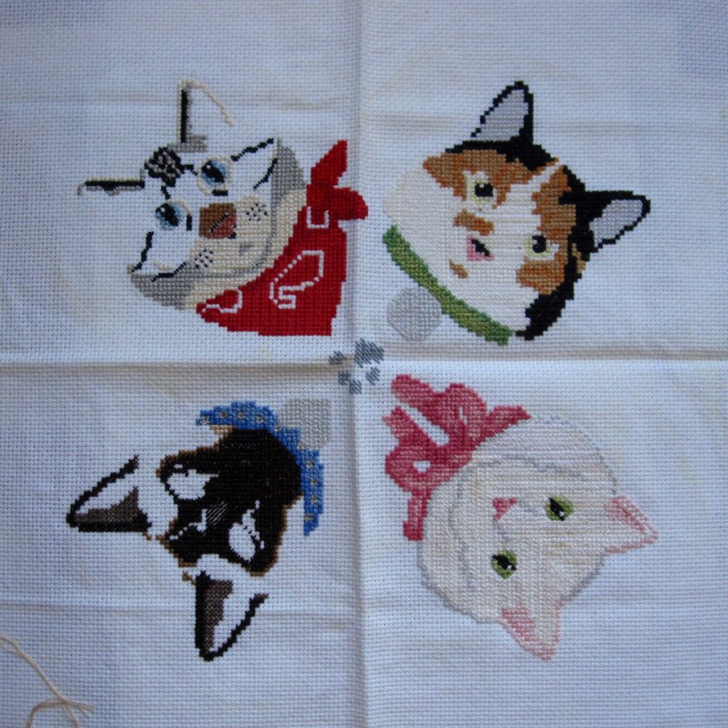 unfinished cat cross-stitch