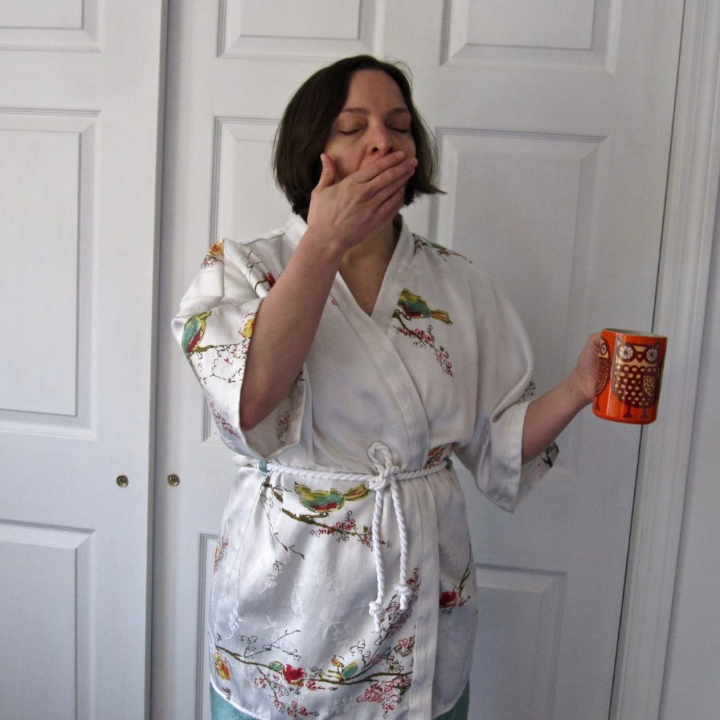 bathrobe on, from the front