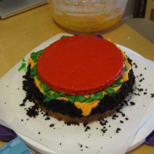 tomato slice on the cake/burger