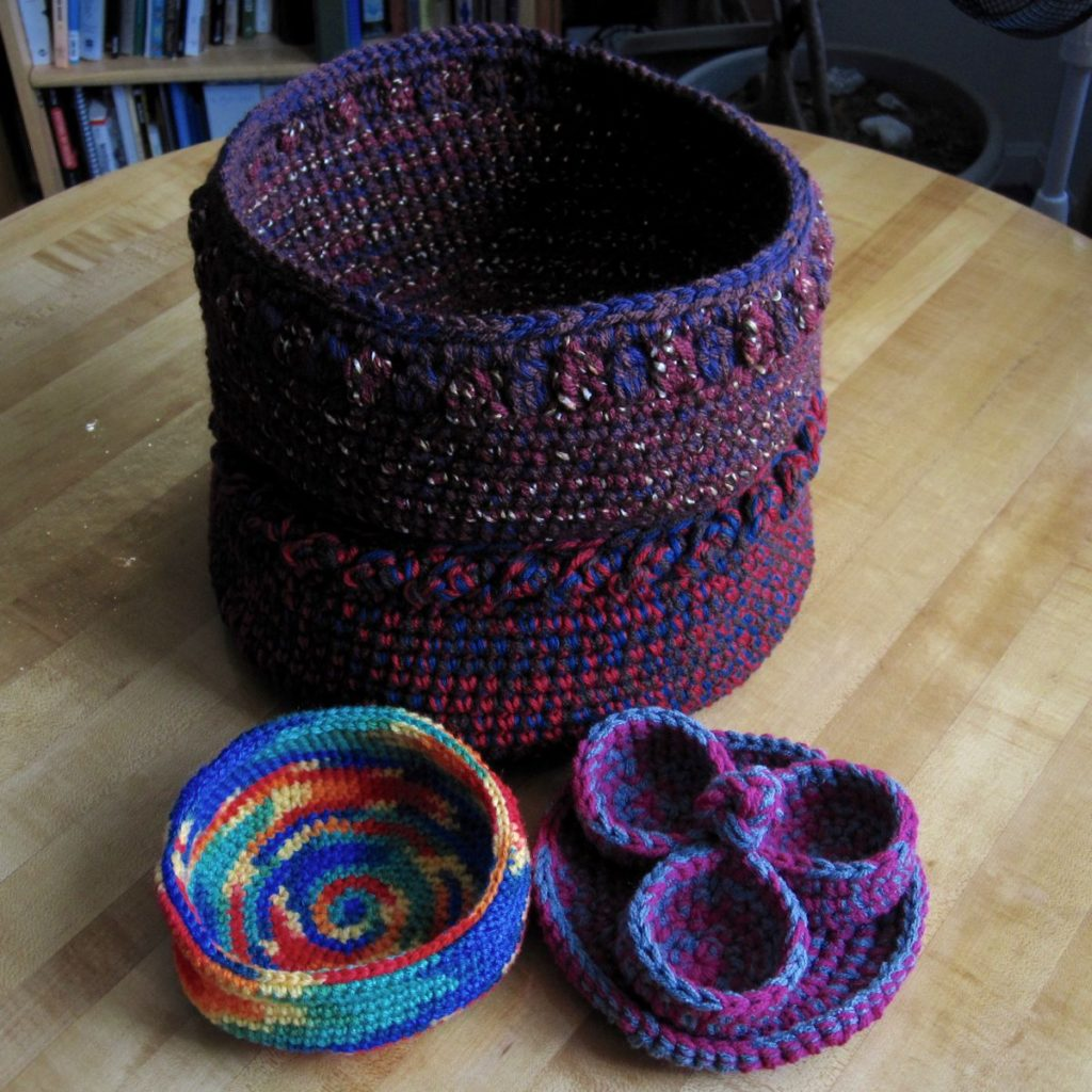 crochet baskets all together